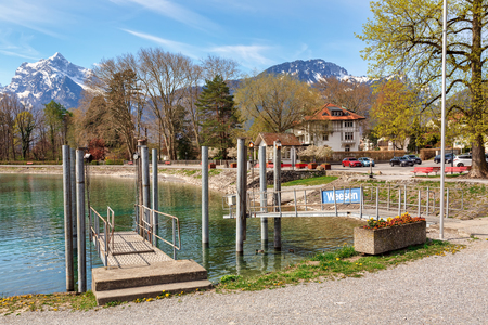 View of the Weesen ferry station on Walensee lake on a sunny spring day. Village of Weesen, See-Gaster, canton of St. Gallen, Switzerland.
