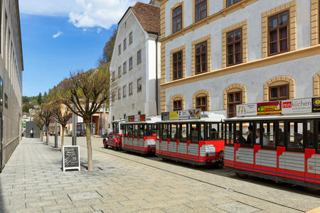 VADUZ, LIECHTENSTEIN - APRIL 16, 2019. Mini train riding in front of the National Museum along the Staedtle street. City of Vaduz, Liechtenstein.