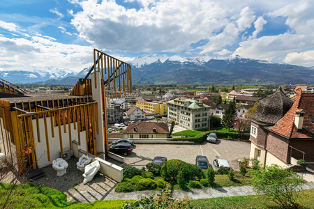 Aerial view of the city centre and the snow-capped Alps. City of Vaduz, Liechtenstein.