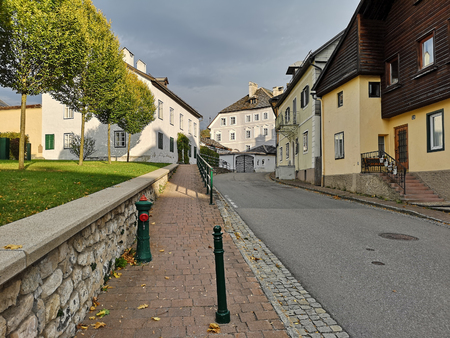 Residential neighborhood on a sunny autumn day. Town of Bad Aussee, district Liezen, Salzkammergut region, state of Styria, Austria, Europe.