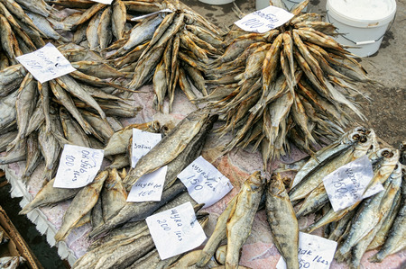 Dried salted fish lying on the counter. Perch, zaban, pike, sabrefish. City market, Russia