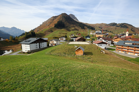 View from above at the village of Warth against the Alps on a sunny autumn day. District of Bregenz, state of Vorarlberg, Austria, Europe. 写真素材