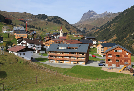 Alpine village of Warth surrounded by the Alps on a sunny autumn day. District of Bregenz, state of Vorarlberg, Austria, Europe. 写真素材