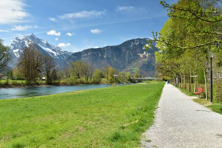 Linth river. View of the Linthdammweg promenade. Village of Weesen, See-Gaster, canton of St. Gallen, Switzerland. 写真素材