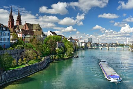 Old town Grossbasel with Basler Muenster Cathedral on the banks of the Rhine river on a sunny spring day. City of Basel, Switzerland, Europe. 写真素材
