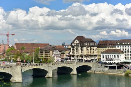 BASEL, SWITZERLAND - APRIL 17, 2019. Rhine river on a spring sunny day. View of the Middle Bridge. City of Basel, Switzerland, Europe.