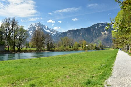 Promenade Linthdammweg along the Linth river. View of the Alps. Village of Weesen, See-Gaster, canton of St. Gallen, Switzerland. 写真素材