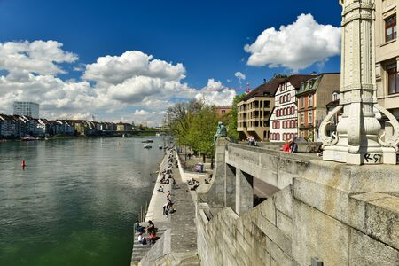 BASEL, SWITZERLAND - APRIL 17, 2019. View from the Middle Bridge at the embankment of the Rhine river. City of Basel, Switzerland, Europe.