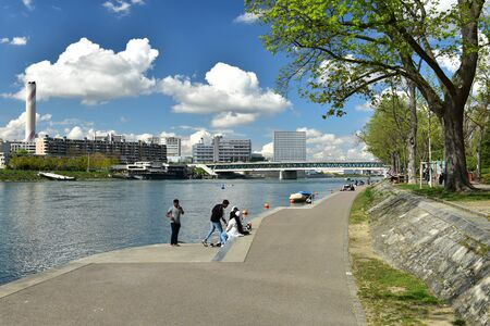 BASEL, SWITZERLAND - APRIL 17, 2019. Embankment of the Rhine river. View at the modern neighborhood. City of Basel, Switzerland, Europe