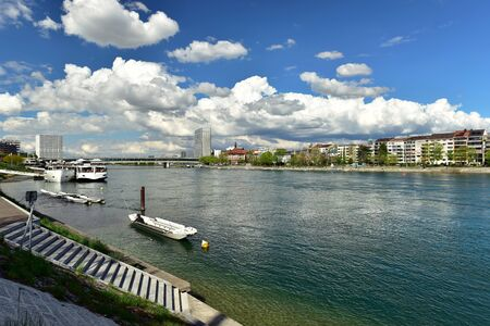 BASEL, SWITZERLAND - APRIL 17, 2019. Rhine river in the town center. View of the passenger boat terminal St. Johann. City of Basel, Switzerland, Europe.