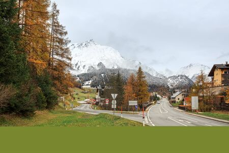 View of the alpine village of Nauders and snow-capped Alps in autumn. District of Landeck in the Austrian state of Tyrol, Europe.