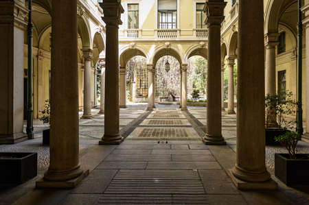 MILAN, ITALY - APRIL 17, 2018. Inner courtyard of old building in the historical center of Milan, at the intersection of streets Via dei Giardini and Via Borgonuovo. Region of Lombardy, Italy, Europe.