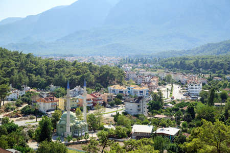 KEMER, TURKEY - AUGUST 21, 2014. Aerial view of the Aslanbucak neighborhood of Kemer, surrounded by Olympos Beydaglari National Park. Town of Kemer, Antalya province, Turkey.