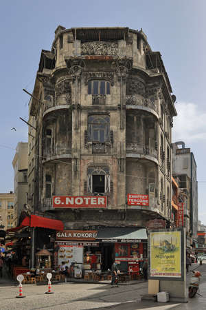 ISTANBUL, TURKEY - OCTOBER 05, 2020. Multistory historical building with restaurant located in Buyuk Postane street, at Sirkeci quarter of Fatih district in Istanbul, Turkey.