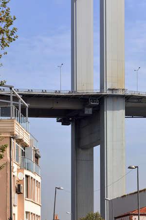 Bosporus bridge over residential house. Besiktas district, city of Istanbul, Turkey. 写真素材