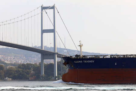 ISTANBUL, TURKEY - OCTOBER 06, 2020. Crude Oil Tanker sailing in front of the Bosphorus Bridge in the Bosphorus Strait. View of the Asian side. City of Istanbul, Turkey.