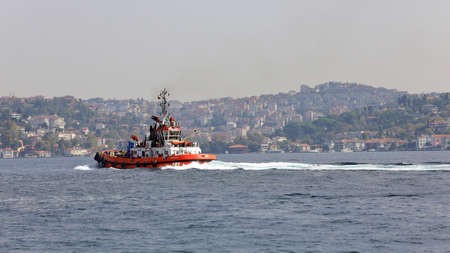 ISTANBUL, TURKEY - OCTOBER 06, 2020. Red ship in the Bosphorus Strait. View of the Asian side. City of Istanbul, Turkey. 報道画像