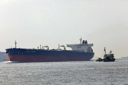 ISTANBUL, TURKEY - OCTOBER 06, 2020. Huge Crude Oil Tanker and small vessel sailing in the Bosphorus Strait. City of Istanbul, Turkey.