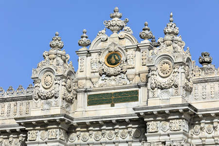 Dolmabahce Palace of 19th century. Exterior facade of the Gate of Treasury. Besiktas district, city of Istanbul, Turkey.