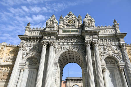 ISTANBUL, TURKEY - OCTOBER 06, 2020. Dolmabahce Palace of 19th century. Exterior facade of the Gate of Treasury. Besiktas district, city of Istanbul, Turkey.