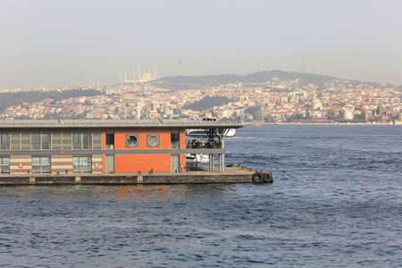 Newly-built Karakoy pier in the Golden Horn as seen from Galata Bridge. View of the Uskudar district on the Anatolian shore of the Bosphorus. City of Istanbul, Turkey.