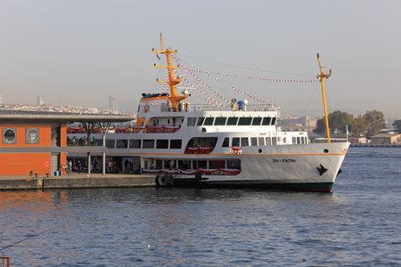 ISTANBUL, TURKEY - OCTOBER 06, 2020. Newly-built Karakoy pier in the Golden Horn. Passenger ship moored at the pier. City of Istanbul, Turkey.