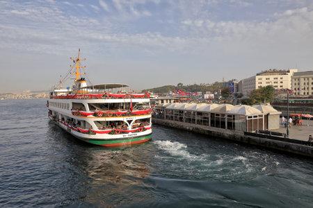 ISTANBUL, TURKEY - OCTOBER 06, 2020. Passenger ship on the Golden Horn, as seen from the Galata Bridge. View of the Eminonu Pier Kadikoy. City of Istanbul, Turkey.