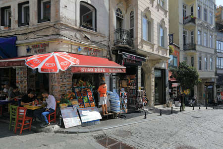 ISTANBUL, TURKEY - OCTOBER 07, 2020. Outdoor cafe on the corner of the Galip Dede Street. Beyoglu district, city of Istanbul, Turkey.