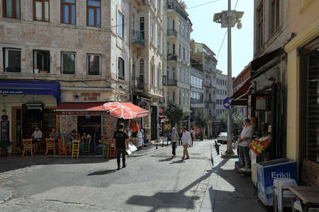 ISTANBUL, TURKEY - OCTOBER 07, 2020. Outdoor cafe on the corner. Galip Dede Street during pandemic time. Beyoglu district, city of Istanbul, Turkey. 報道画像
