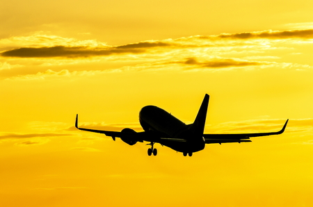 Boeing  silhouette against the background of the golden sky