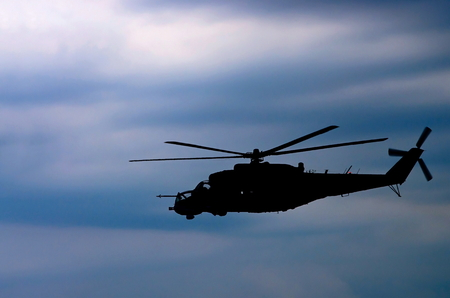 combat helicopter against the sky