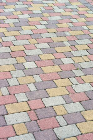 walking paths: background from multi-colored paving pavers, at walking paths Stock Photo