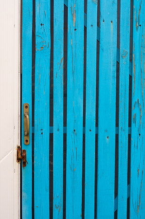 wicket: wicket door with a handle made of boards turquoise
