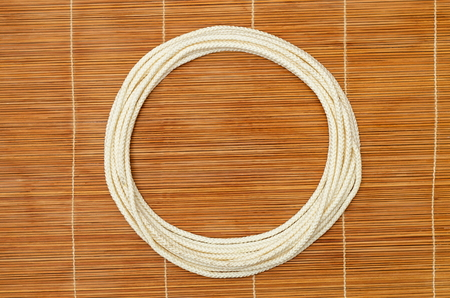 Rope ring, on a wooden background