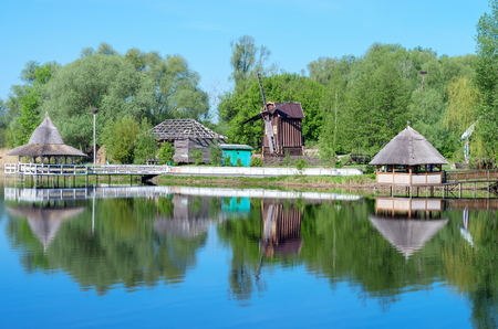 wooden pergolas on the river bank, mill Stock Photo