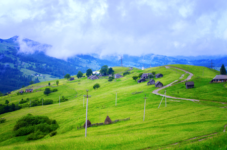 low clouds over the village in the mountains. Ukraine Carpathians