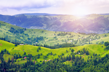 hills mountain slope of the Carpathians, beautiful scenery. houses of the village of Ukraine