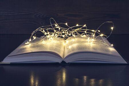 open book light garland in the dark, monochrome toning