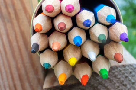 multicolored wooden pencils in a box close-up