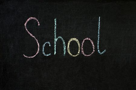 inscription in chalk on a blackboard - school, colored letters