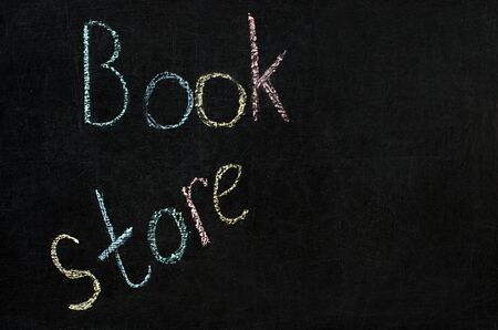 inscription on the blackboard with multi-colored chalk - store book