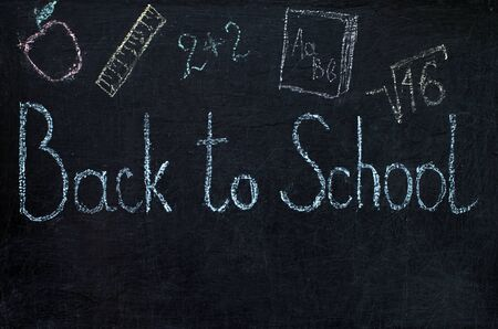inscription on blackboard - back to school