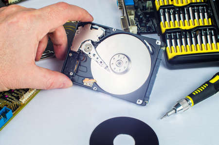 technician makes a hard drive dissection, computer repair, tools