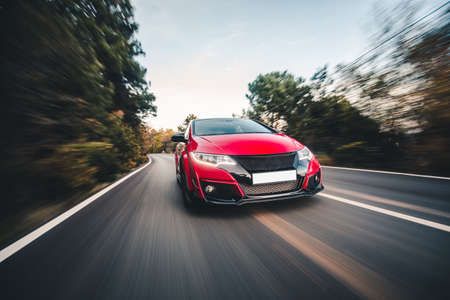 Red sport high speed drive on the road