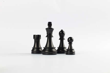 Black rook, queen, pawn and bishop isolated on white background