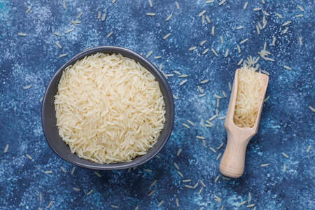 Rice flakes,rice noodles,rice bread and rice on dark background,top view Фото со стока