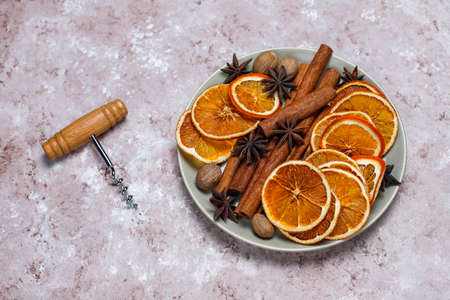 Mulled wine recipe ingredients on brown concrete background ,christmas or winter warming drink.
