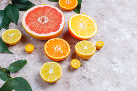 Citrus background with assorted fresh-citrus fruits,lemon,orange,lime,mandarin,kumquat,grapefruit fresh and colorful,top view