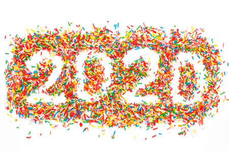 Creative Happy New 2020 Year. Colorful number shape with bright rainbow sugar sprinkles isolated on white