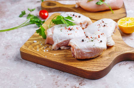 Raw chicken meat fillet, thigh, wings and legs with herbs ,spices,lemon and garlic. Top view Stockfoto